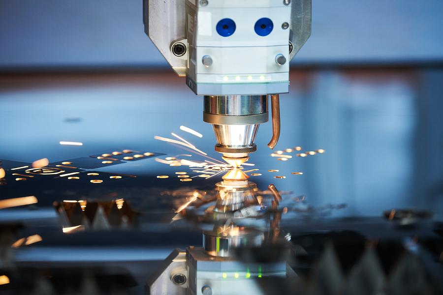 artist engraver doing laser engraving