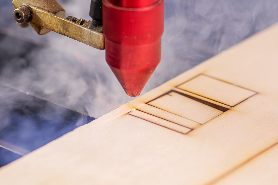 laser cutting beam high precision on a plywood sheet
